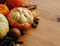 Seasonal wooden table setting with small pumpkins Stock Photos