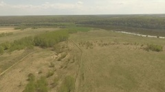 Flight over the spring valley and the river Stock Footage