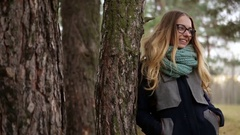 Girl in a pine forest cold autumn Stock Footage
