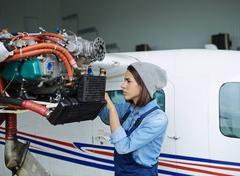 Professional troubleshooting engineer repairing air jet Stock Photos