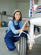 Professional troubleshooting engineer repairing air jet Stock Photos