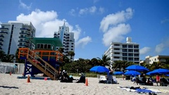 MIAMI BEACH -People enjoy the beach on a beautiful sunny day. The Stock Footage