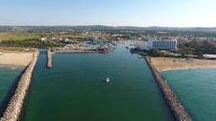 Flying above the entrance to the port, with a yacht marina Stock Footage