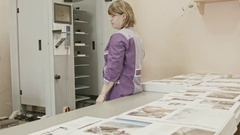 Woman working with touch screen on polygraph folder machine in printing house Stock Footage
