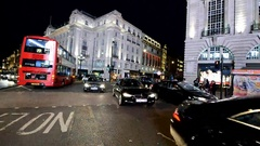 LONDON - JUNE 2015: Piccadilly traffic at night. London attract 15 million Stock Footage