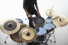 Overhead Shot Of Drummer Playing Drum Kit In Studio Stock Photos