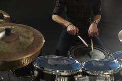 Close Up Of Drummer Playing Snare Drum On Kit In Studio Stock Photos