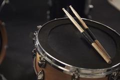 Close Up Of Sticks Resting On Snare Drum Stock Photos
