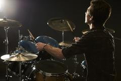 Rear View Of Drummer Playing Drum Kit In Studio Stock Photos