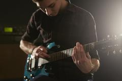 Close Up Of Man Using Tapping Technique On Electric Guitar Stock Photos