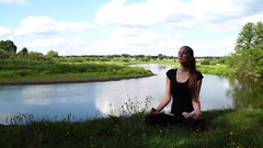 Girl in good physical shape, on a background of nature, the river and clouds Stock Footage