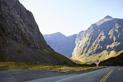 Road Through Mountains Near Milford Sound In New Zealand Stock Photos