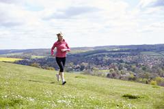 Mature Woman Jogging In Countryside Stock Photos