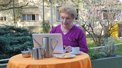 Retired woman confident with laptop making breakfast outdoor Stock Footage