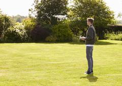Man Flying Drone Quadcopter In Garden Kuvituskuvat
