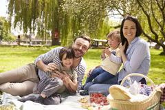 Family Enjoying Riverside Picnic Together Stock Photos