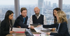 4K Corporate business team meeting, looking at papers with data & demographics Stock Footage