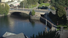 Early morning traffic over a bridge in downtown Tampere, Finland Stock Footage