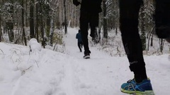 Group of athletes runners run a winter forest in snow Arkistovideo