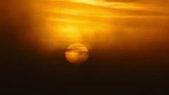 Sun rising in fog, telephoto 4k Stock Footage