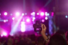 Fan Taking Photo On Camera At Music Festival Stock Photos