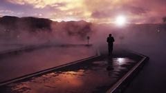 Silhouette of man walking through the mist Stock Footage