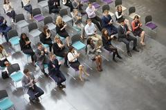 Overhead View Of Audience Applauding Speaker At Conference Stock Photos