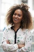 Head And Shoulders Portrait Of Young Businesswoman In Office Stock Photos