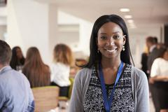 Portrait Of Female Delegate During Break At Conference Stock Photos