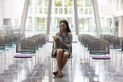 Businesswoman In Empty Auditorium Preparing To Make Speech Stock Photos