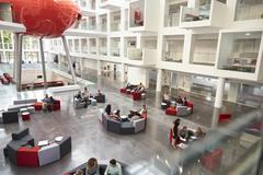Students in a modern university atrium, view from mezzanine Stock Photos