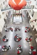 Seating in the atrium of modern university building, vertical Stock Photos