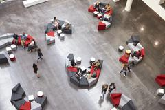Students in the atrium of modern university, elevated view Stock Photos