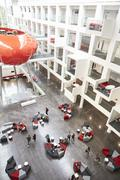Modernist interior of a university atrium, vertical Stock Photos