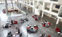 Elevated view of seating in a university atrium, motion blur Stock Photos