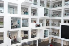 Wide view of students in study cubicles in modern university Stock Photos