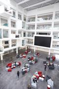 Modern university lobby atrium and study rooms, vertical Stock Photos