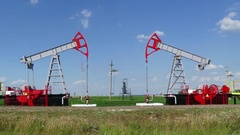 Working oil pumps in row at sunny day, timelapse Stock Footage