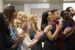 Adult students applauding at an event in their university Stock Photos