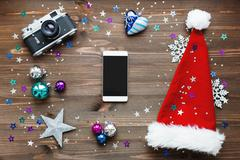 Christmas and New Year background with smartphone, old fashioned camera, red  Stock Photos