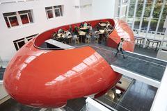 Design of university mezzanine social area, elevated view Stock Photos