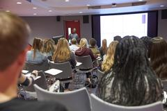 Student lecture in modern university classroom, back view Kuvituskuvat