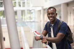 Smiling black male student in modern university, portrait Kuvituskuvat