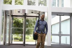Middle aged black man in the foyer of a large modern building Stock Photos
