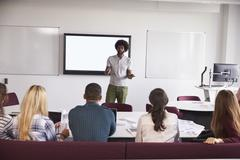 University Students Attending Lecture On Campus Stock Photos