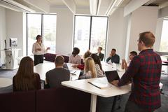 Group Of University Students Attending Lecture On Campus Stock Photos