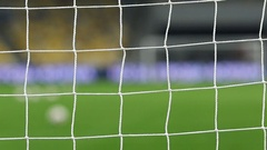 View of goal net with soccer pitch background Stock Footage