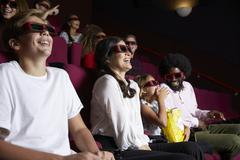Audience In Cinema Wearing 3D Glasses Watching Comedy Film Kuvituskuvat