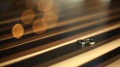 Wedding rings lying on the table Stock Footage