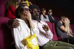 Couple In Cinema Wearing 3D Glasses Watching Comedy Film Kuvituskuvat